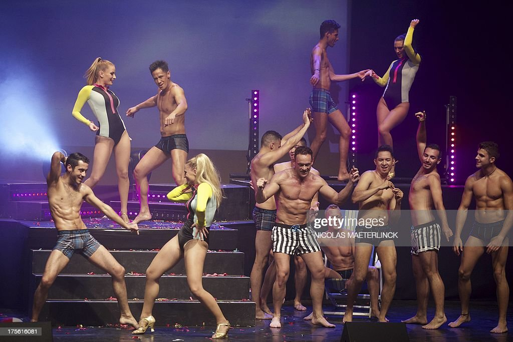 People take part in the finals of the Mr Gay World competition as part of the World Outgames in Antwerp on August 4, 2013. The World Outgames is an international sports and culture event, sponsored by the Gay and Lesbian International Sport Association.