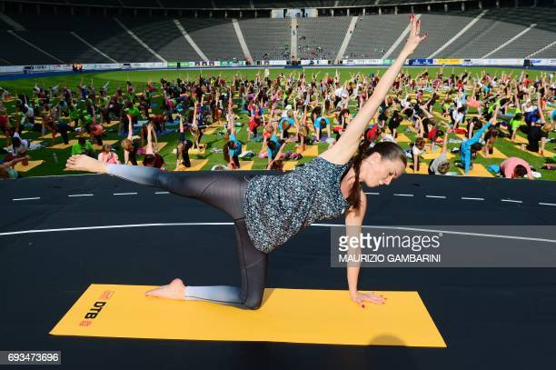People take part in the FitnessDanceYogaEvent during the 2017 Deutsches Turnfest at the Olympic Stadium in Berlin on June 7 2017 / AFP PHOTO / dpa /...
