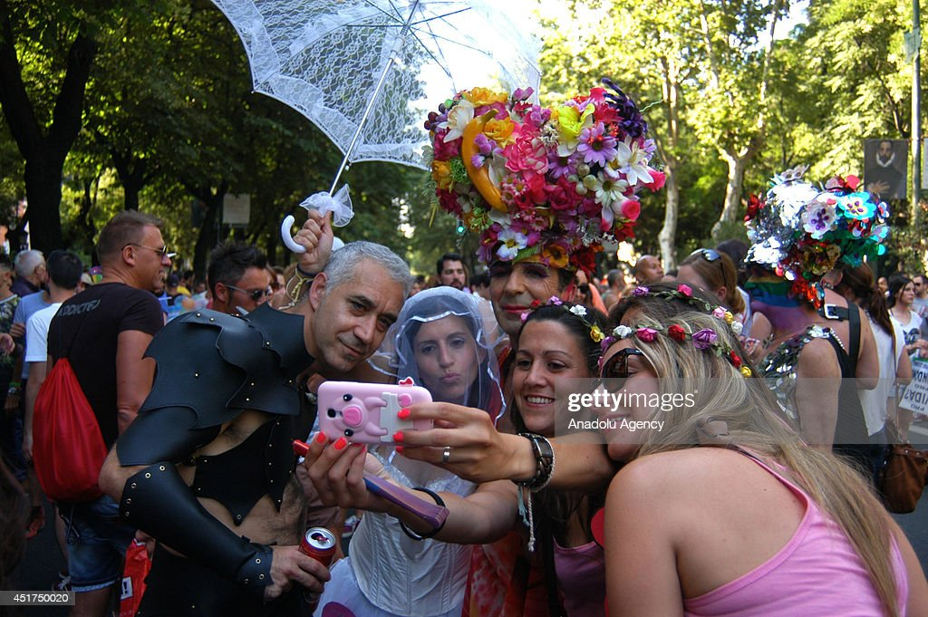 People take part in the Gay Pride Parade on July 5, 2014 in Madrid, Spain. The annual LGBT march has the theme 'Nos Manifestamos Por Quienes No Pueden' (We march for those who can not) on this year.
