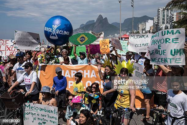 People take part in the Global Climate March at Ipanema beach in Rio de Janeiro Brazil on November 29 on the eve of the UN conference on climate...