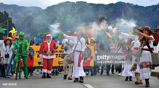 People take part in the Global Climate March in Bogota Colombia on November 29 on the eve of the UN conference on climate change COP 21 to take place...