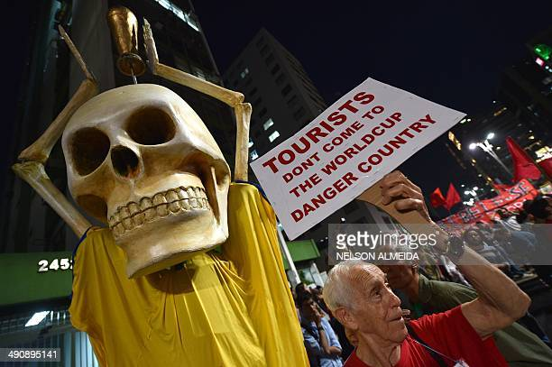People take part in the 'International Day of World Cup Resistance' protest against the upcoming FIFA World Cup Brazil 2014 along the streets of Sao...