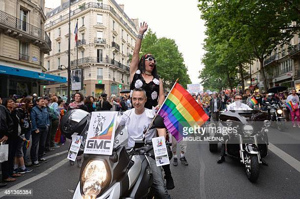 People take part in the lesbian gay bisexual and transgender visibility march the Gay Pride on June 28 2014 in Paris AFP PHOTO / MIGUEL MEDINA