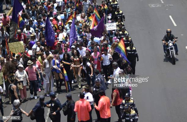 People take part in the Lesbian Gay Bisexual Transsexual and Transgender Pride Parade in Iztapalapa in Mexico City on May 13 2017 / AFP PHOTO / Pedro...