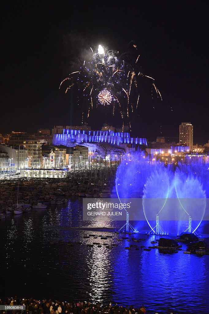 People take part in the light parade on January 12, 2013 in the Vieux-Port harbour of French southern city of Marseille, part of the launching of Marseille-Provence 2013 European Capital of Culture. The event marks the start of a year, leading to a cultural renaissance in France's second-largest metropolitan area.