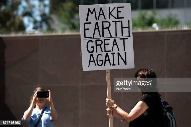 People take part in the March for Science in Los Angeles California on April 22 2017 The event which coincides with Earth Day was held in protest of...