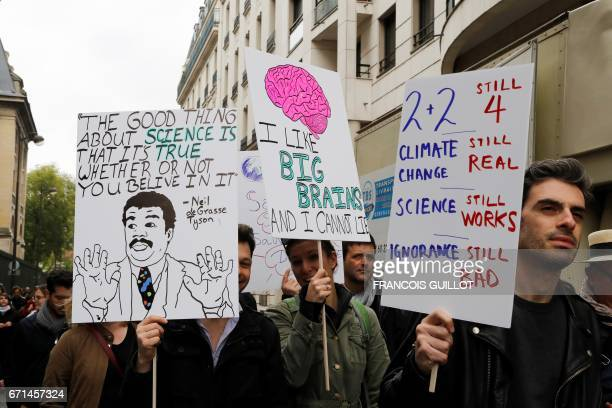 People take part in the March for Sciences as part of Earth Day 2017 in Paris on April 22 to defend science and scientific integrity and to call for...