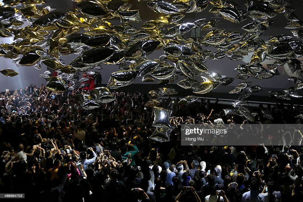 People take part in the Michael Kors Jet Set Experience fashion show on May 9, 2014 in Shanghai, China.