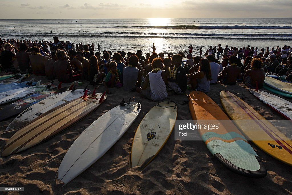 People take part in the Paddle for Peace ceremony at Kuta Beach as part of the Bali Bombing 10th anniversary on October 12, 2012 in Jimbaran, Bali, Indonesia. Thousands of family members, friends and general public gathered to remember the victims of the 2002 Kuta nightclub bombings which killed 202 people, including 88 Australians.