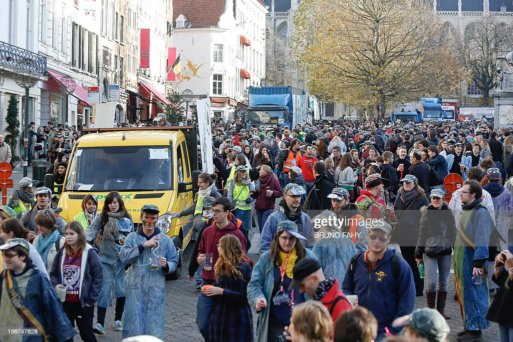 People take part in the parade of the 'Universite Libre de Bruxelles' (ULB) and the Vrije Universiteit Brussel (VUB) celebrating St V (for Saint-Verhagen or Sint-Verhaegen), the founder of the university on November 20, 212 in Brussels.