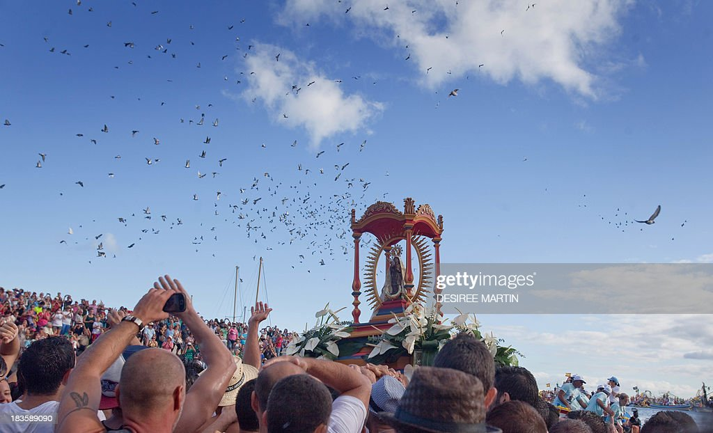 People take part in the pilgrimage of the Virgin of Guadalupe in San Sebastien de la Gomera on the Spanish Canary Islands of Tenerife on October 7...