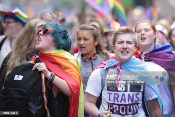 People take part in the Pride Glasgow parade through the city centre