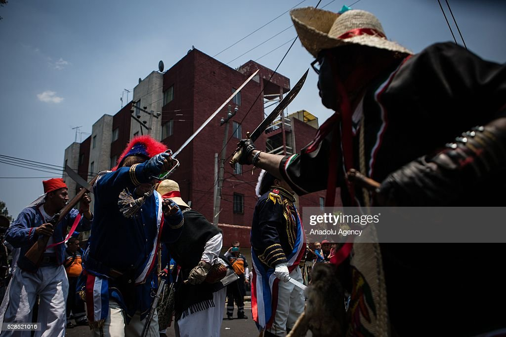 People take part in the representation of the 5th of May Battle where the Mexican Army defeat the French Army in 1862, in Mexico City, Mexico on May 05, 2016. This representation is made by residents of a popular neighborhood in the west of Mexico City for over 80 years.