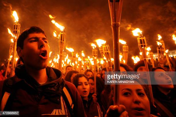 People take part in the torchlight procession in Yerevan late on April 24 2015 Armenians commemorate on April 24 a hundred years since 15 million of...