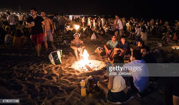 People take part in the traditional Bonfires of Saint John festival at a beach in Alicante Spain on June 23 2015 AFP PHOTO/ JOSE JORDAN