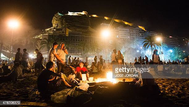 People take part in the traditional Bonfires of Saint John festival at a beach in Alicante Spain on June 23 2015 AFP PHOTO/ JOSE JORDAN / AFP / JOSE...