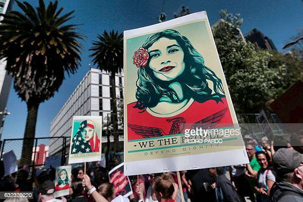 People take part in the 'Women´s March' against new US President Donald Trump in Mexico City on January 21 2017 / AFP / PEDRO PARDO