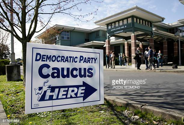 People take part in Washington State Democratic Caucuses at Martin Luther King Elementary School in Seattle on March 26 2016 / AFP / Jason Redmond