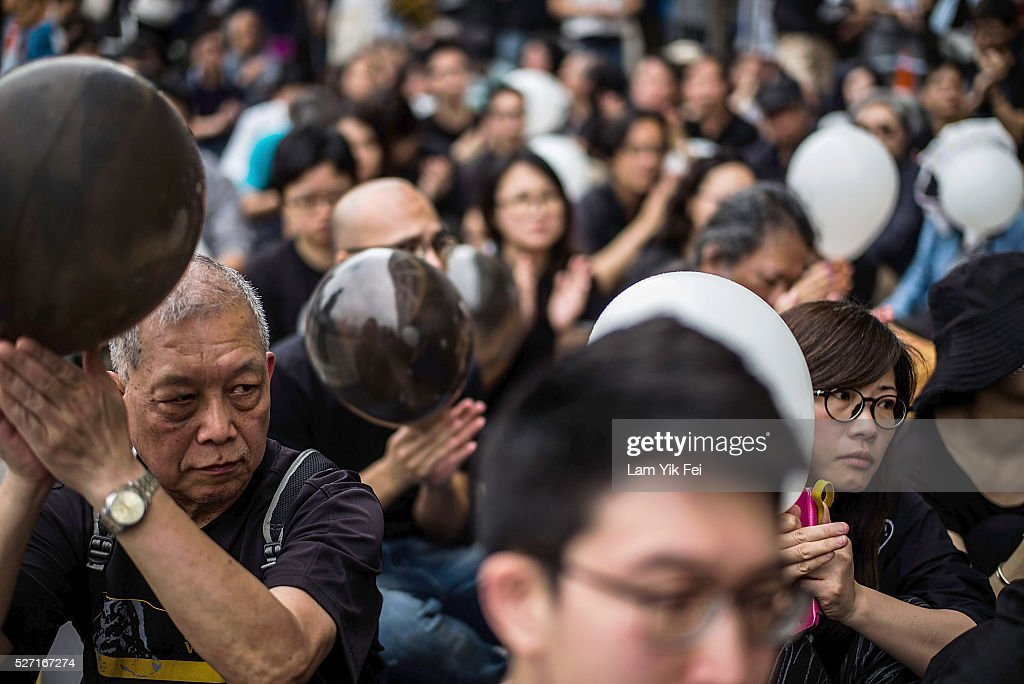 People take part of the rally outside Ming Pao building on May 2, 2016 in Hong Kong. Ming Pao sacked its executive chief editor, Keung Kwok-yuen, on 20 April after the Hong Kong newspaper published a front page story on the offshore holdings uncovered by the Panama Papers of some of Hong Kong's top businessmen and politicians. Journalists from the Chinese-language daily paper has since protested against the controversial decision to fire its executive chief editor which deepened concern about press freedom in the city.