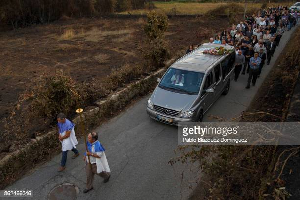 People take part on the funeral of a victim of a wildfire in the village of Vila Nova near Vouzela on October 17 2017 in Viseu region Portugal At...