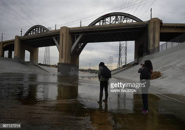 People take photographs as they come to say goodbye to the iconic 6th Street Bridge that connects downtown Los Angeles with its eastern disticts...
