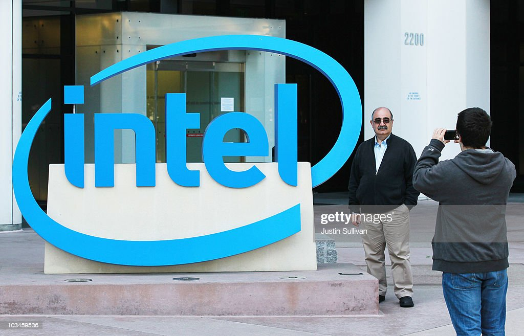 People take photographs in front of the Intel logo outside of an Intel office August 19, 2010 in Santa Clara, California. Intel announed today that it plans to buy security software maker McAfee for a reported $7.68 billion.