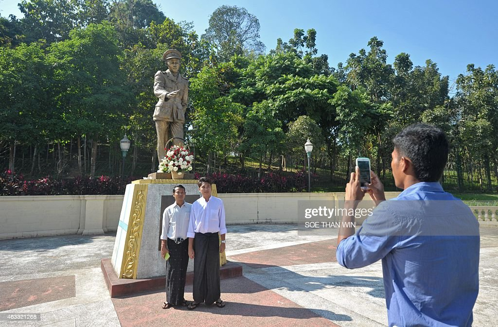 People take photographs in front of the late General <a gi-track='captionPersonalityLinkClicked' href=/galleries/search?phrase=Aung+San&family=editorial&specificpeople=812845 ng-click='$event.stopPropagation()'>Aung San</a> statue during to mark the 100th birthday of independence hero <a gi-track='captionPersonalityLinkClicked' href=/galleries/search?phrase=Aung+San&family=editorial&specificpeople=812845 ng-click='$event.stopPropagation()'>Aung San</a>, in Yangon on February 13, 2015. Known affectionately as 'Bogyoke', or General, <a gi-track='captionPersonalityLinkClicked' href=/galleries/search?phrase=Aung+San&family=editorial&specificpeople=812845 ng-click='$event.stopPropagation()'>Aung San</a> is adored in Myanmar and credited with unshackling the country from colonial rule and embracing its ethnic minorities in a vision of unity that unraveled catastrophically in the military-dominated decades that followed his 1947 assassination.