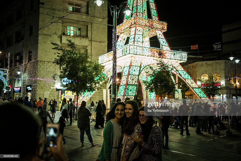 People take photographs near the Light Festival on May 26, 2016 in Jerusalem, Israel. The Light Festival, which features both Israeli and international artists, takes place annually in Jerusalem's Old City and the surrounding areas.