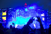 People take photographs of a giant sculpture on the main stage at the Alfa Future People electronic music festival in Nizhny Novgorod Russia on...
