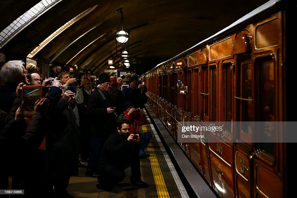 People take photographs of the newly restored steam engine built in 1898, known as Met Locomotive No. 1, arrive at Baker Street Underground station in a recreation of the first London Underground journey on January 13, 2013 in London, England. The London Underground celebrates its 150th birthday this month, the Metropolitan line being the first stretch between Paddington and Farringdon stations.