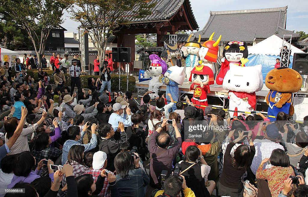 People take photographs Yuru Chara during the 'Yuru Chara Festival in Hikone' at Yumekyobashi Castle Road on October 23, 2010 in Hikone, Shiga, Japan. Yuru Chara, abbreviation of 'Yurui (unserious or relaxing)' and 'Character', are mascots of local governments, companies etc. The festival attracts 35,000 Yuru Chara fans.