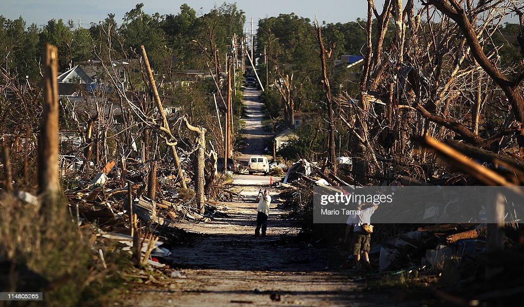 People take photos after a massive tornado passed through the town killing at least 126 people on May 26, 2011 in Joplin, Missouri. The town continues the process of recovering from the storm which damaged or destroyed an estimated 8,000 structures.
