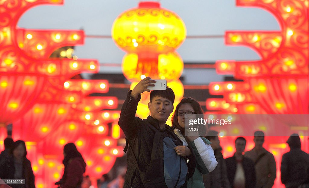 People take photos during a lantern show at Confucius Temple on January 26, 2014 in Nanjing, China. Chinese people are preparing for the Spring Festival, the year of horse, which will fall on January 31 according to Chinese calendar.