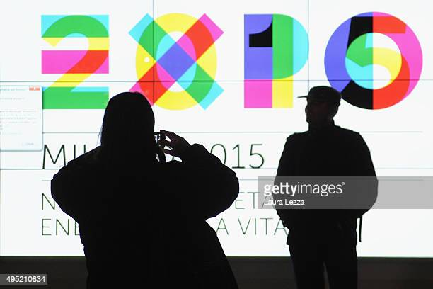 People take photos during the closing day of the exhibition on October 31 2015 in Milan Italy The gates of the Universal Exhibition EXPO 2015 closed...