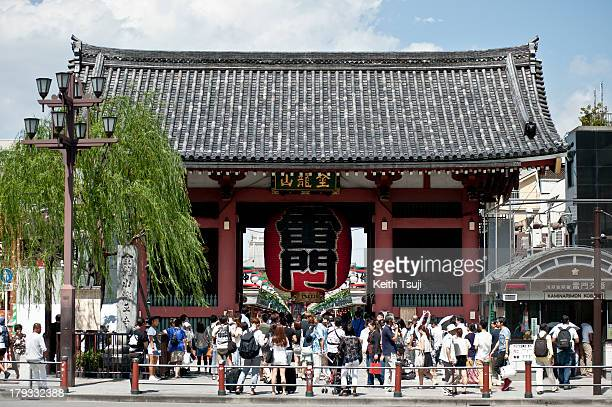 People take photos in front of the Kaminarimon Gate in Asakusa on September 1 2013 in Tokyo Japan Tokyo is one of the candidate cities bidding to...
