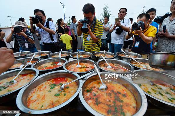 People take photos of mutton during a mutton food festival opening on July 11 2015 in Xiaoxian County Suzhou City Anhui Province of China Over ten...