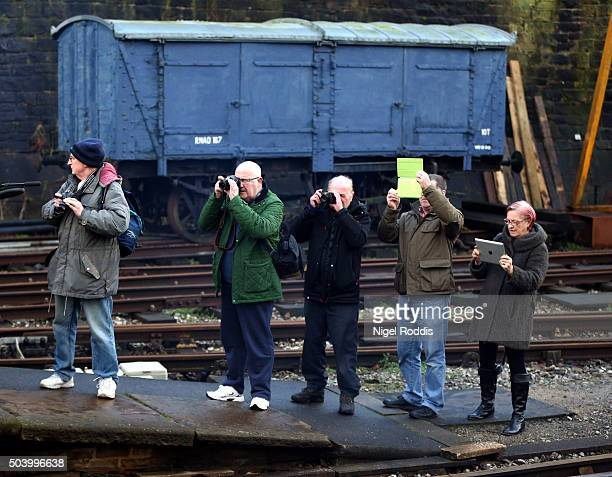 People take picture of The Flying Scotsman during a test run along the East Lancashire line for the first time in ten years on January 8 2016 in Bury...