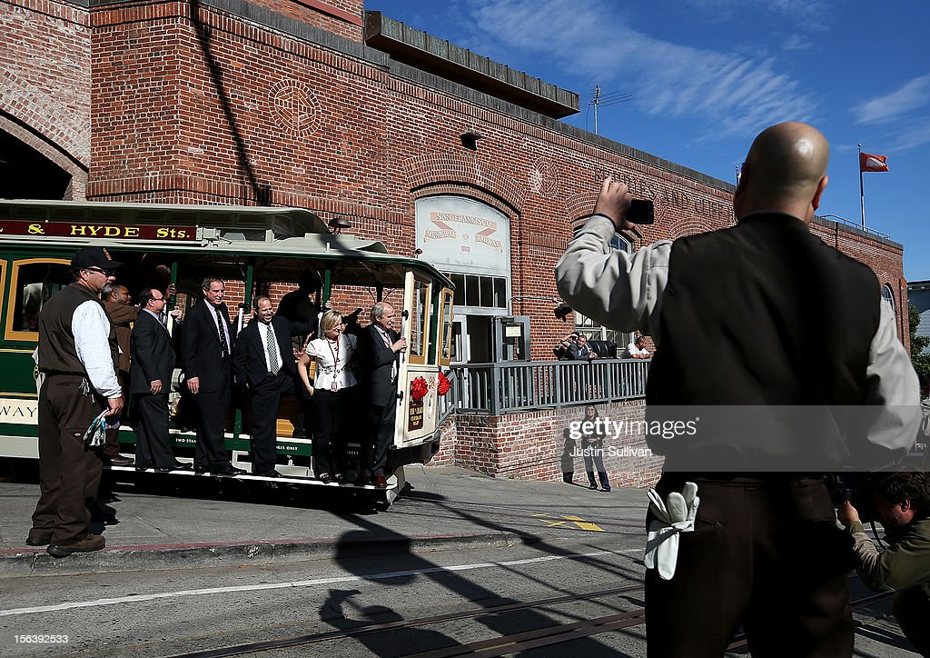 People take pictures as San Francisco Cable Car #26 pulls out of the barn during a service inauguration ceremony for the newly restored vintage Cable Car on November 14, 2012 in San Francisco, California. A service inauguration ceremony kicked off a new life for San Francisco Cable Car #26 that was originally built in 1890 and has been fully restored by hand and put back in service on the streets of San Francisco.
