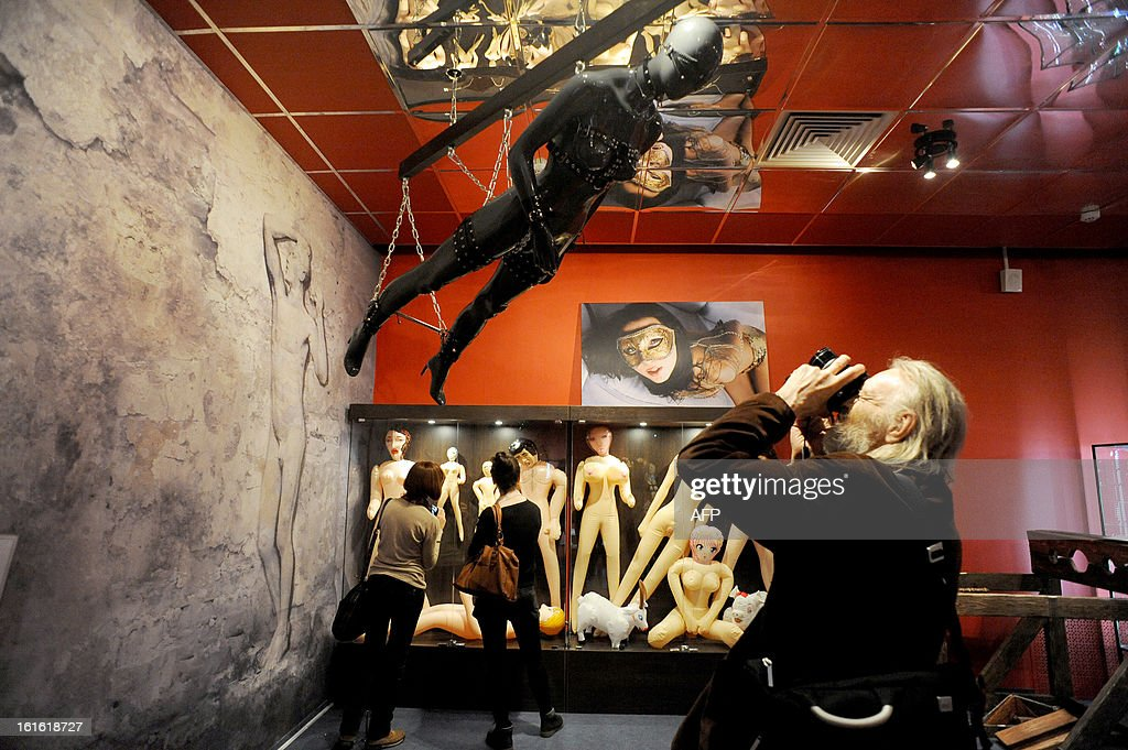 People take pictures as they visit 'MuzEros', an erotic museum, shortly after its opening in Russia's second city of St. Petersburg on February 13, 2013. The museum exhibits a collection of sexual artifacts from around the world, the museum organizers said.