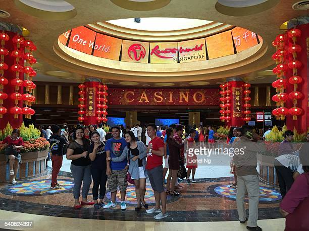 People take pictures at the entrance of the casino on the first day of Chinese New Year on Sentosa Island in Singapore