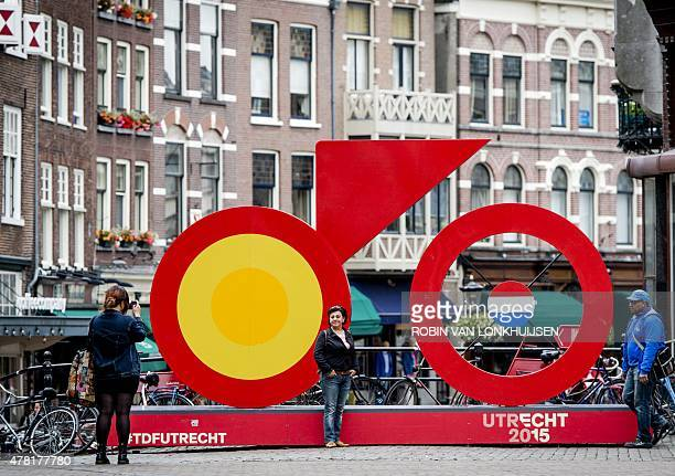 People take pictures by decorations set for the upcoming Tour de France cycling race in downtown Utrecht on June 23 2015 The 102nd edition of the...