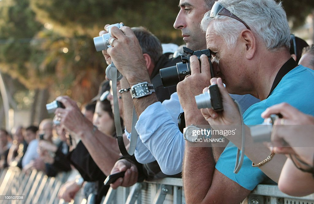 People take pictures during the Canal+ TV show 'Le Grand Journal' during the 63rd Cannes Film Festival on May 20, 2010 in Cannes.