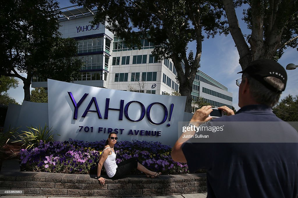 People take pictures in front of a sign that posted in outside of the Yahoo headquarters on May 23 2014 in Sunnyvale California
