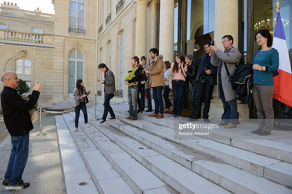 People take pictures in the courtyard of the Elysee Presidential Palace during the 30th edition of France's European heritage days on September 15, 2013 in Paris, France. Monuments and state buildings are opened for free for two days to the public.
