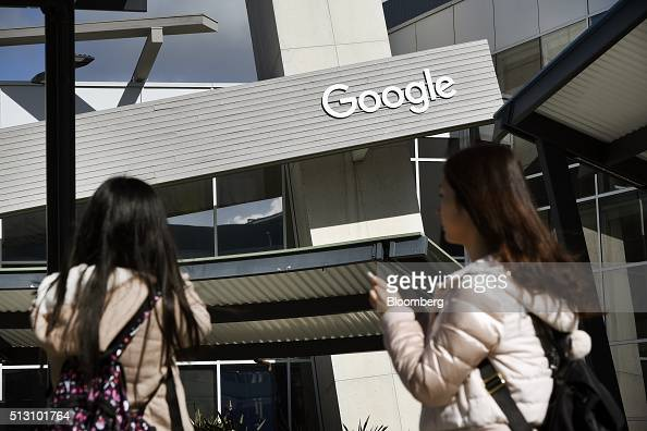 People take pictures of a Google Inc office building inside the Googleplex headquarters in Mountain View California US on Thursday Feb 18 2016 Google...