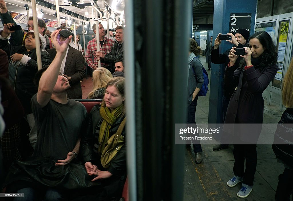 People take pictures of a vintage New York City subway car as it sits in the 2nd Ave. station on December 16, 2012 in New York City. The New York Metropolitan Transportation Authority (MTA) runs vintage subway trains from the 1930's-1970's each Sunday along the M train route from Manhattan to Queens through the first of the year.