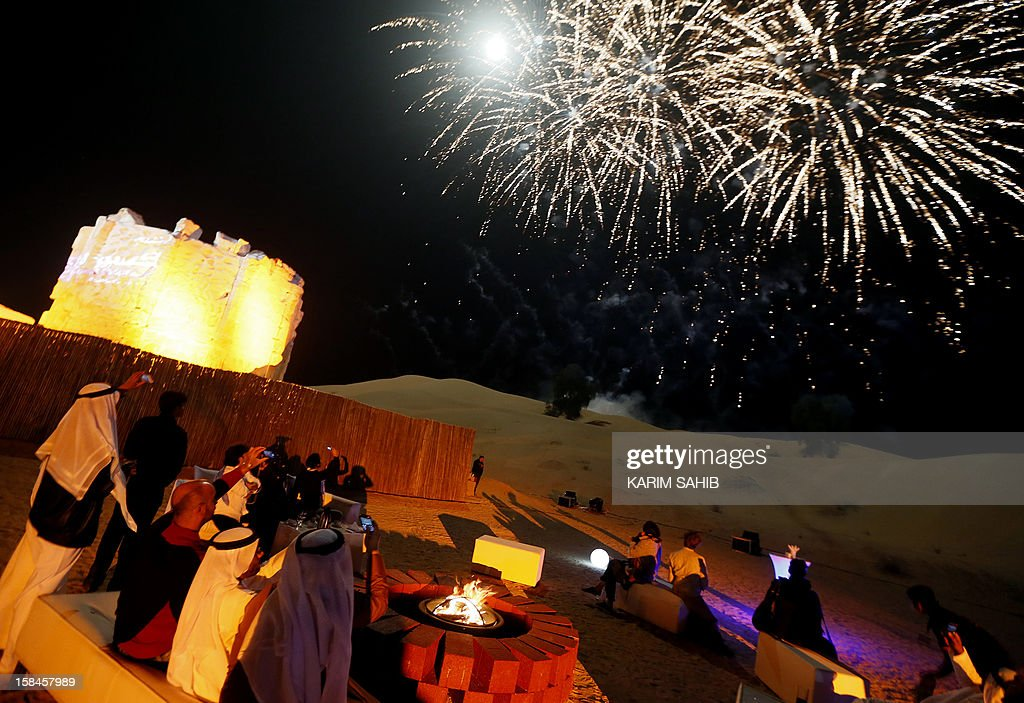 People take pictures of fireworks at the closing ceremony of the 9th annual Dubai Film Festival, during a display held in the desert on the outskirts of Dubai on December 16, 2012. Saudi movie 'Wadjda,' a tale of a girl's quest to own a bicycle in the kingdom where women are deprived of many rights, won the best Arabic feature film at the festival.