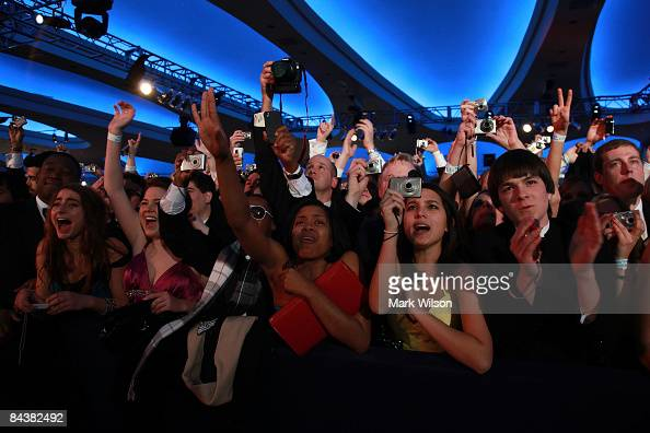 People take pictures of US President Barack Obama as he arrives on stage duringduring MTV ServiceNation Live From The Youth Inaugural Ball at the...