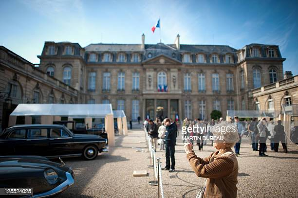 People take pictures while visiting the courtyard of the Elysee presidential palace on September 18 in Paris during the 27th edition of France's...