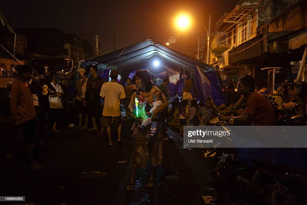 People take refuge from the floods in temporary shelters in East Jakarta district on January 18, 2013 in Jakarta, Indonesia. According to the National Disaster Management Agency, about 50 percent of the capital is under water following the floods which have so far claimed eleven lives and displaced thousands of Indonesians.